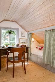 bedroom lighting pleasant sloped ceiling curtained off bed under sloped ceiling lantlig inredning