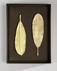 on gold leaf feather wall art with two gold leaves wall art