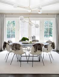 contemporary scandinavian dining furniture. stunning, scandinavian dining room with large round table, white chairs, faux fur hung contemporary furniture