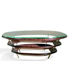 this exquisite coffee table is comprised of three parallel irregular rings veneered with ebony macassar