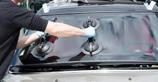 technicican replacing car windshield sylv1rob1 shutterstock com
