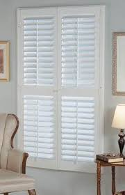 white window shutters.  Shutters White Or Oak Colors  Plantation Shutters Intended Window D