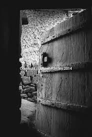 door ajar old wooden door of abandoned house in salalah dhofar oman