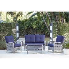 lakewood ranch 4 piece gray resin wicker patio conversation set with coffee table and navy blue cushion