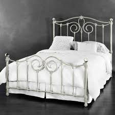 Black bed with white furniture Matte Black Eldridge Iron Bed In Distressed White W Acrylic Finials West Elm Highend Iron Beds Wrought Iron Beds Humble Abode