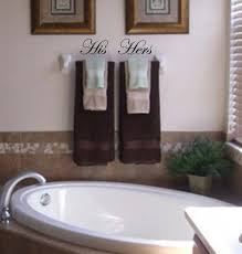 his and hers bathroom set. his and hers vinyl wall decals. $6.00, via etsy. neat idea for bathroom set t