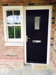 black posite front door with flanking cream pvc u sliding sash window a nod