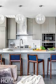 one of our goals was to provide plenty of storage says duffy of the new kitchen which has gone thoroughly modern with leucos pendants and quartz