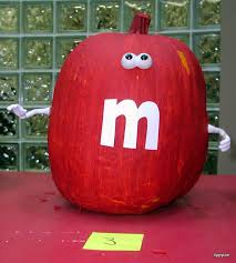 the kids painted several several layers of red paint onto the pumpkin and then we used mr potato head pieces again the m was made from white paper
