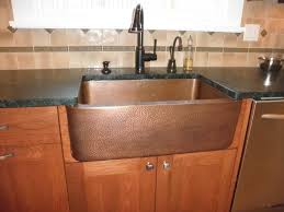 Black Apron Front Kitchen Sink Brown Stainless Steel Sink With Black Faucet Placed On The Brown