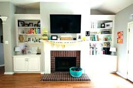 tv above fireplace ideas how to hide wires for wall mounted over fireplace hanging over fireplace