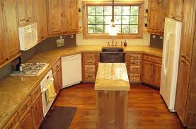 a large kitchen with concrete countertops in light brown and tan colors