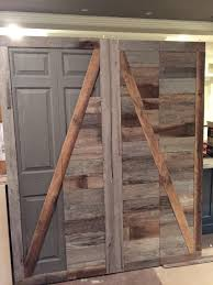 Create a beautiful reclaimed wood barn door from an ugly bifold ...