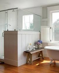 View in gallery Rustic wooden bench in farmhouse bathroom