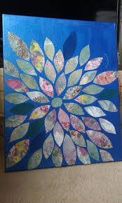 painted canvas with acrylic paint cut leaf petal designs from sbook paper and mod