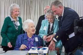 Doreen Hodgman (left), Effie Matthews, Dot Shields and Peter Hodge (right)  cut the Hobart Legacy cake for the three women's birthdays. - ABC News  (Australian Broadcasting Corporation)