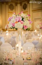 stylish wedding centerpiece with tall vase