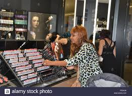feven armstrong checks out the latest looks at mac cosmetics at the fort hood texas