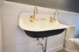 wall mount double sink. Small And Deep White Sink With Double Nickel Faucets That Is Mounted On Wall System For Mount