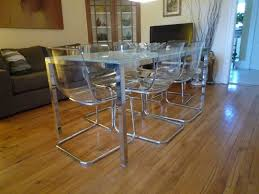 modern gl and stainless set dining room