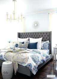 blue and white bedding spring in full swing home tour grey upholstered bed white bedding and