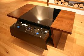 now this table is made by surface tension in the uk who makes a range of coffee table arcade machines which can be found at