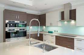 A Lovely Small Kitchen With High End Appliances And A Mixture Of White And  Wood