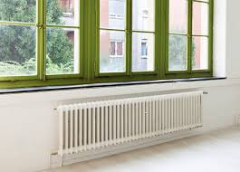 where to position a radiator in a room