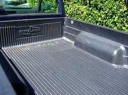 a drop in brand bedliner when inserted inside the truck