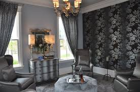 black and silver living room decor with unique wall art and gold mirrors also classic chandelier lamp shade