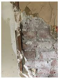 where the brick chimney meets drywall