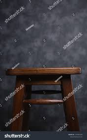 Wooden Bar Stool On Grey Background Stock Photo Edit Now