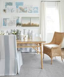 indoor wicker dining chair and table in blue and white dining room designed by suzanne