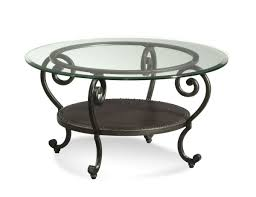 full size of frameless round glass top table with black coated metal legs in classic style
