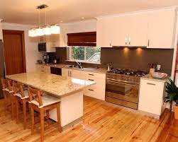 kitchen designs adelaide. 40mm stone bench tops with laminate doors, stainless steel kick boards and painted glass splash kitchen designs adelaide