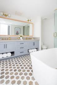 blue double washstand with gray quartz countertop