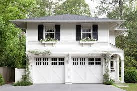 cottage garage doorsWhite Brick Home with Black Garage Doors  Cottage  Home Exterior