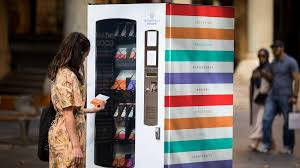 A Vending Machine Dispenses Coffee Into Beauteous This Artwork Is A Vending Machine That Dispenses 'snacks' Based On