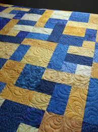 Tamarack Shack: Yellow Brick Road & This is Sandra's Yellow Brick Road quilt and I quilted a free hand teardrop  shape in the center using a blue variegated Lava thread. Adamdwight.com