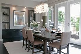 linear crystal drop chandelier above minimalist dining table furniture and brown leather armless chairs