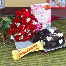 Roses And Cake With Toblerone Chocolates For Birthday Wishes