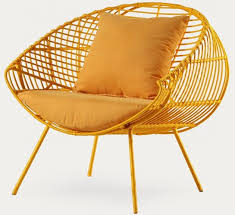 gold arm chair by philippine contemporary furniture designer murillo