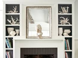 amazing living room with silver leaf beveled mirror leaning against white fireplace mantel painted creamy white benjamin moore white dove flanked by small