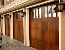 do you have a craftsman style home or carriage house that needs a fetching new garage door if so consider installing a barn door garage door to