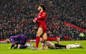 Liverpool goes 16 points clear by beating Man United 2-0 ...