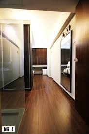 the master bedroom is divided into 2 sections by the floor to ceiling wardrobe to demarcate