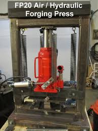 having seen t a toler s design where he uses a relatively inexpensive 20 ton air actuated bottle jack and welded steel frame i got to thinking that i