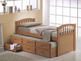 beige wooden twin bed frame with drawers underneath also soft grey bedding set and rug on white glossy flooring idea