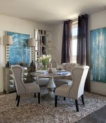 dining room metallic silver round pedestal dining table linen tufted dining chairs