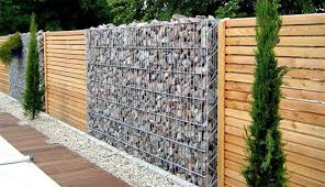 Rocks, metal wire, wood fence design